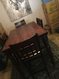 Oval brown wooden dining table with 4 chairs Edmonton, T6L 3K8