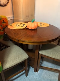 Solid wood Ashley Pub style table with leaf and 4 chairs Paid $1000 Negotiable Excellent Condition Holtsville, 11742