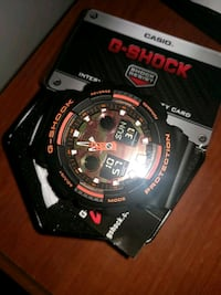 Orange Camo G-SHOCK with warranty card and tags