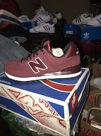 maroon New Balance shoes on box