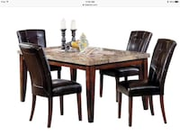 Rectangular brown wooden table with six chairs dining set... worth $1500 at the brick... value of one chair is $149 Mono, L9W