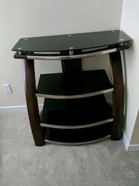 black glass and brown wooden TV stand 532 km