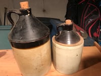 Two white-and-black ceramic bottles