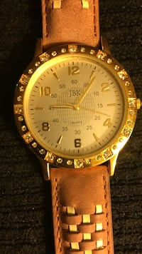Round gold-colored jbk analog watch with brown leather band was asking $60 but reduced down to $40 Warren, 44483