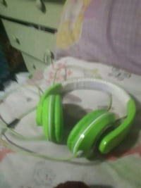 Green head phones works well Langley, V3A 1G2