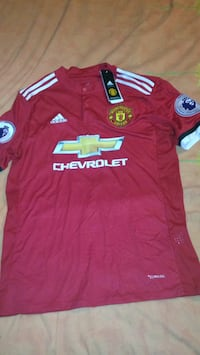 red and white Adidas soccer jersey