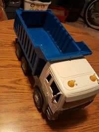 white and blue plastic dump truck toy Sterling, 20164