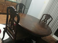 oval brown wooden dining table Louisville