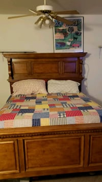 brown wooden bed frame with white and red bed shee Fairview, 97024