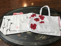 CLARINS New Totes - $12 each or both for $20 Langley, V3A