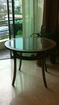 Round brown wooden dining table (4 persons)  Singapore, 247965