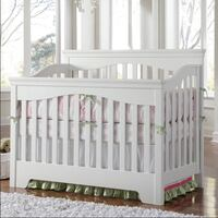 Baby's white wooden crib, young American brand. Converts to toddler bed, gently used. Chesterbrook, 19087