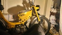 Yellow Pinto motor bike for sale