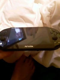 Playstation vita with two games and 4 g memory car Mechanicsburg, 17050