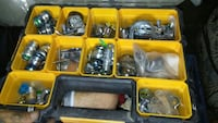 assorted steel component in yellow plastic organizer