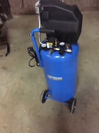 vertical stand blue and black air compressor