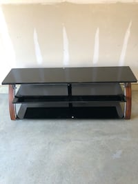"Black glass 65""+ tv stand (excellent condition) Waldorf, 20602"