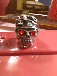 Silver skulls with Ruby eyes ring,size12