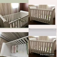 baby's brown wooden crib Mississauga, L5L 3H1