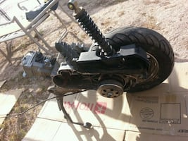 black and gray metal machine 49 cc scooter parts