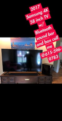 black flat screen TV with brown wooden TV stand Nashville, 37115