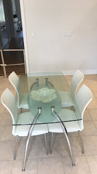 Stainless steel base clear glass top dining table set with chairs . Original price was 1100 Vaughan, L4H 3W9