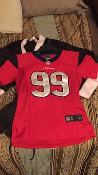 Red and black texas 99 nfl jersey size small. Cross posted