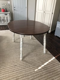 round brown wooden table with white metal base Leander, 78641