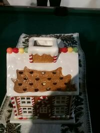 white and brown gingerbread man house figurine