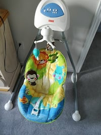 baby's white and green Fisher-Price cradle 'n swing