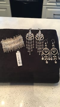 Silver bracelet & 2 pair of silver long earrings all gem encrusted Laval, H7K