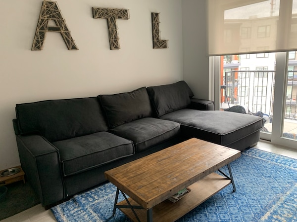 Used Charcoal Grey Fabric Sectional Sofa And Ottoman For Sale In
