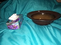 brown ceramic bowl and white tissue paper