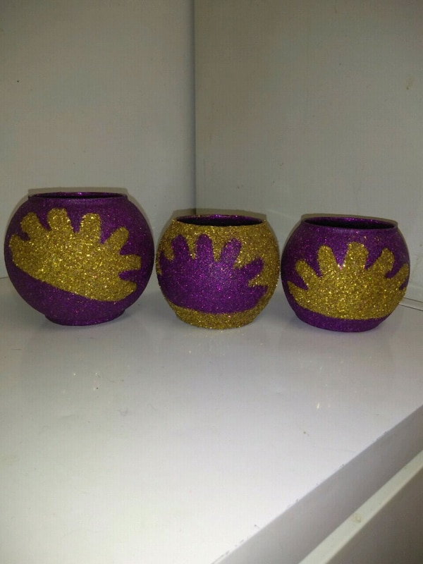 three red and one purple floral ceramic bowls