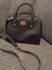 New Michael Kors black leather crossbody purse with gills accents