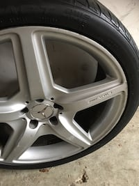 Three gray five spoke car wheels with tires S63 Mercedes-Benz 2008