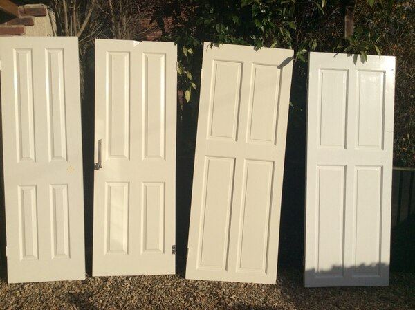4 White painted panelled doors Free if you collect