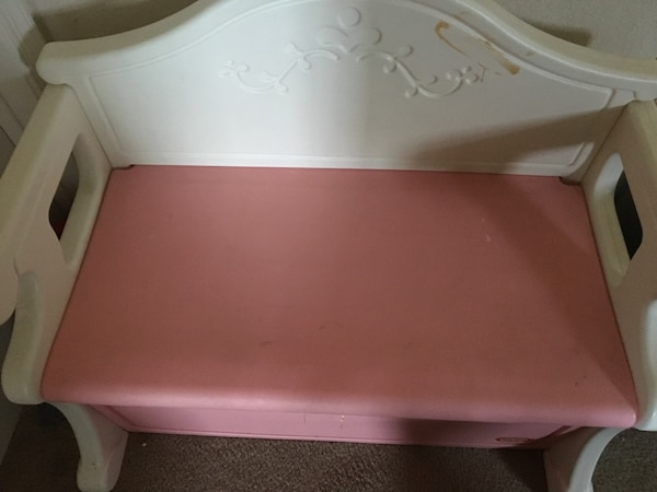 white and pink plastic bench