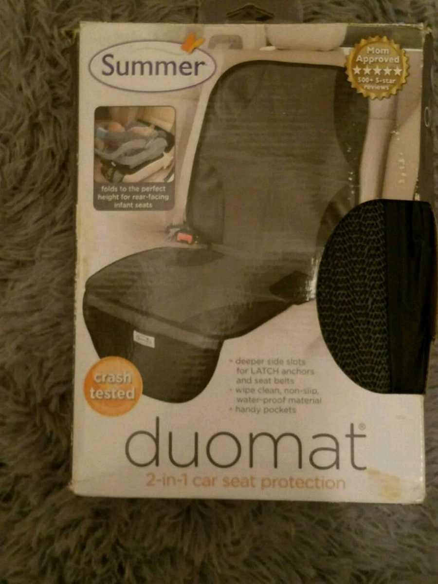Photo Car seat protector like new never used