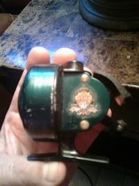 black and green fishing reel