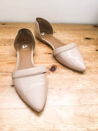 pair of white leather flats