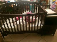 Baby crib with changing station