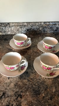four white-red-and-green floral ceramic teacups and four saucers Cantley, J8V 3C2