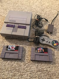 NES console with controller and game cartridges 539 km