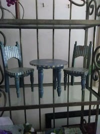 round blue and white striped miniature table with two chairs