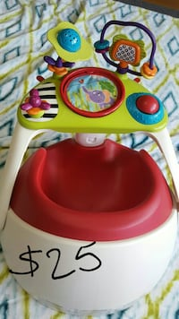 baby's white, red, and green learning floor seat