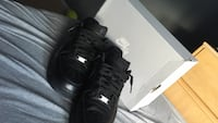 pair of black Nike Air low-top sneakers with gray box Whitby, L1P 1V2