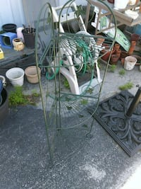 Green metal folding plant stand