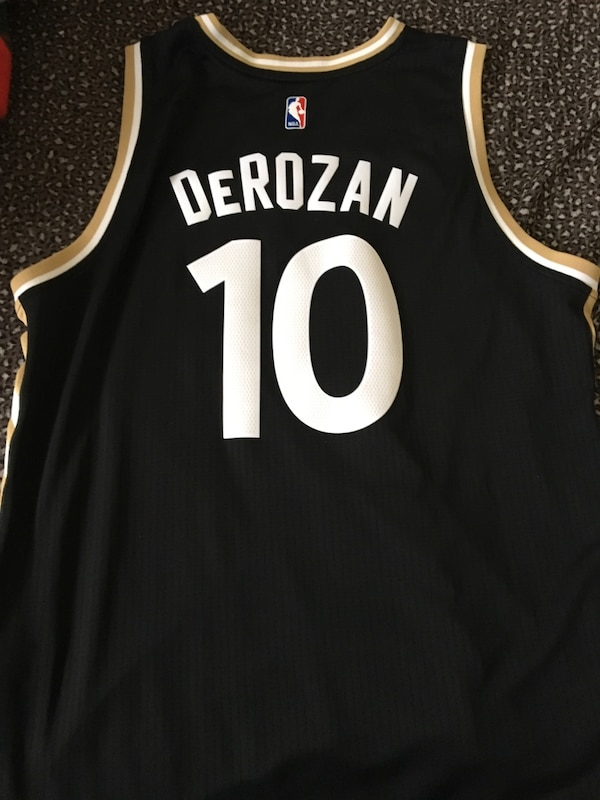 33f5eb73089 1/2. 1/2. Tap to see more pictures. Swipe to see more info. OVO Toronto  Raptors DeROZAN Jersey XL Kids Size