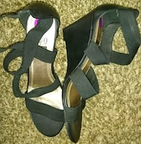 pair of black open-toe ankle strap heels 49 km